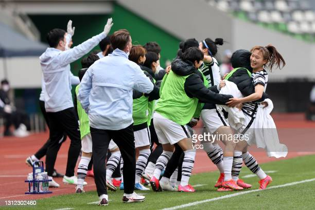 Players of South Korea celebrate a goal during the Tokyo Olympics Women's Football Asian Final Qualifier 2nd leg match between China and South Korea...
