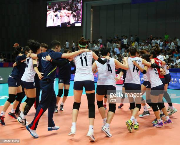 Players of South Korea celebrate after winning China during the FIVB Volleyball Nations League 2018 at Beilun Gymnasium on May 17 2018 in Ningbo China
