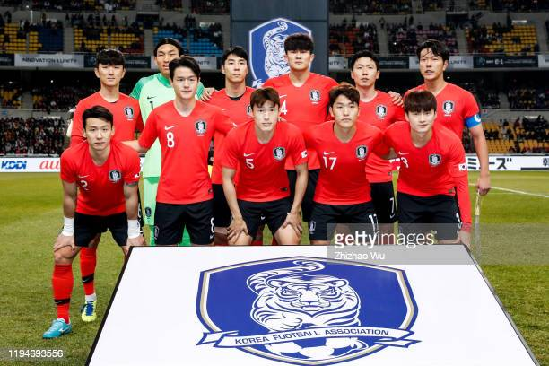 Players of South Korea line up for team photos prior to the EAFF E-1 Football Championship match between South Korea and Japan at Busan Asiad Main...
