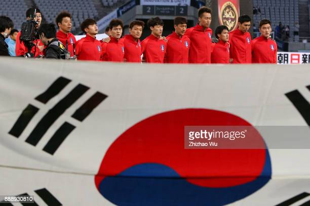 Players of South Korea line up for team photos prior to the match of the EAFF E1 Men's Football Championship between South Korea and China at...