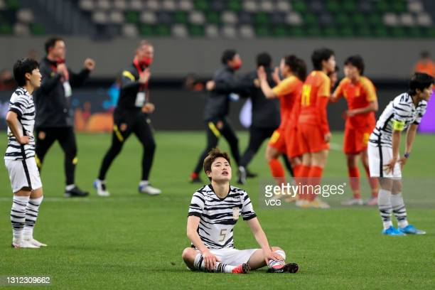 Players of South Korea react after the Tokyo Olympics Women's Football Asian Final Qualifier 2nd leg match between China and South Korea at the...