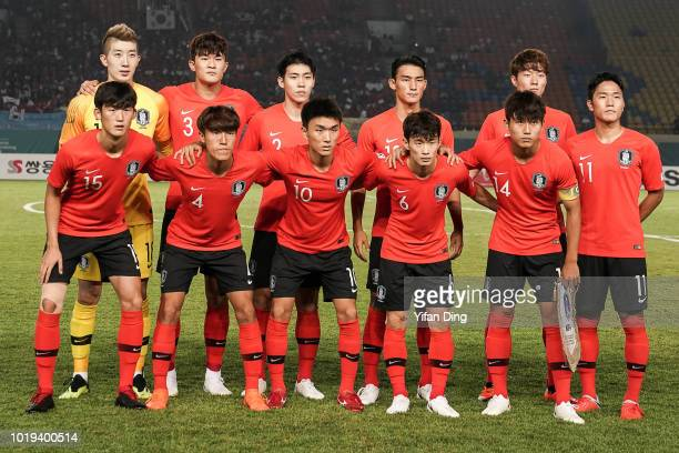 Players of South Korean line up for a group shot prior to the Men's Football Group E match between South Korea and Bahrain at Si Jalak Harupat...