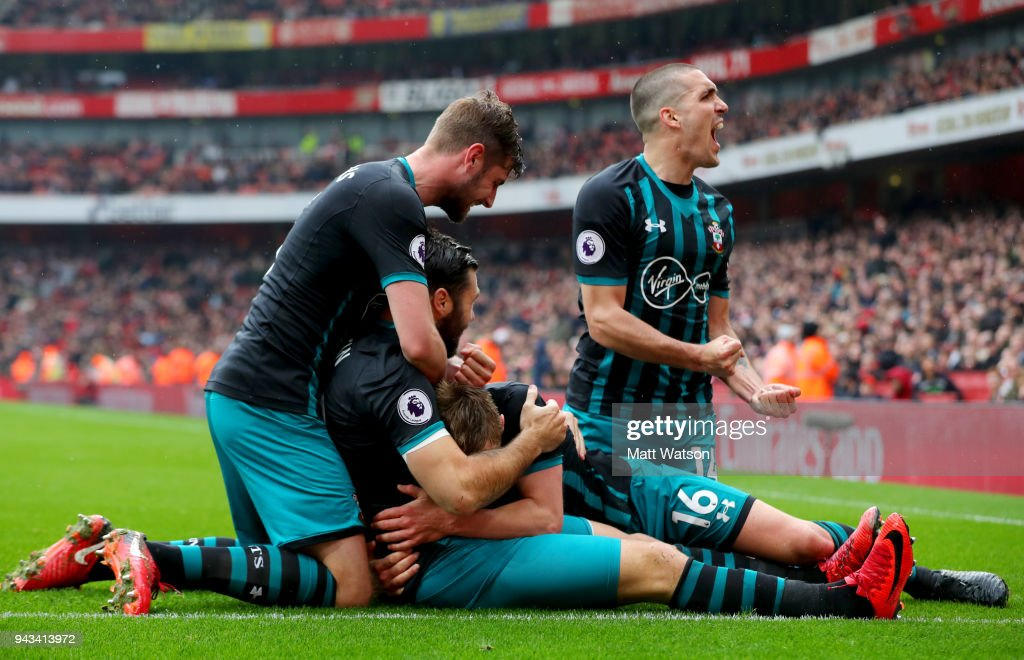 players of Southampton celebrate with team mate Charlie Austin after scores during the Premier League match between Arsenal and Southampton at Emirates Stadium on April 8, 2018 in London, England.