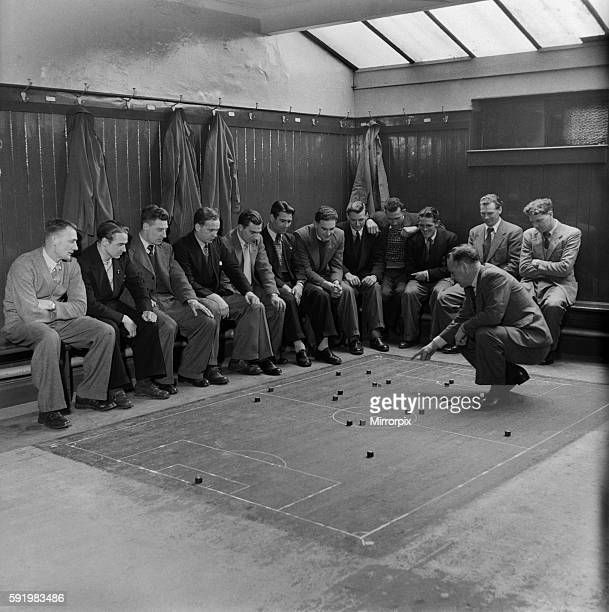 Players of Southampton Football club are given tactical instruction by the manager in the dressing room March 1949 O16889