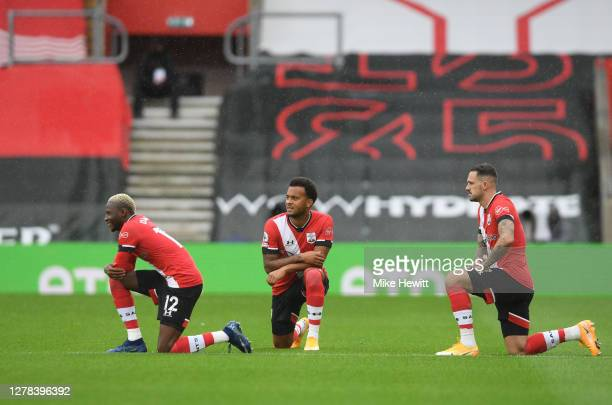 Players of Southampton take a knee in support of the Black Lives Matter movement prior to the Premier League match between Southampton and West...