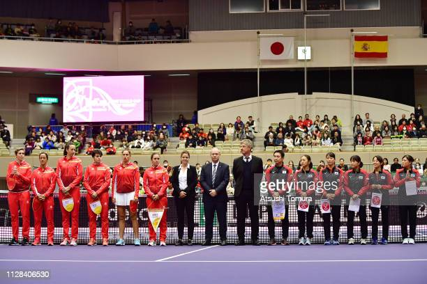 Players of Spain and Japan line up prior to the match on day one of the Fed Cup World Group II match between Japan and Spain at Kitakyushu Sogo...