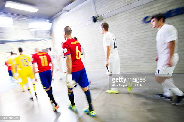 Players of Spain and Kazakhstan enter the pitch before the FIFA Futsal World Cup Round of 16 match between Spain and Kazakhstan at Coliseo Ivan de...