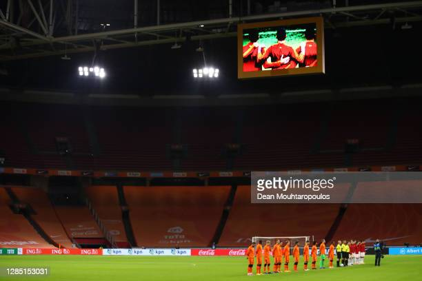 Players of Spain and Netherlands line up for the national anthems prior to the international friendly match between Netherlands and Spain at Johan...