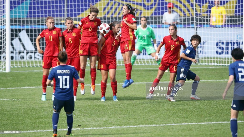 Players of Spain block a freekick from Fuka Nagano of Japan during the FIFA U-20 Women's World Cup France 2018 group C match between Spain and Japan at Stade Guy-Piriou on August 9, 2018 in Concarneau, France.