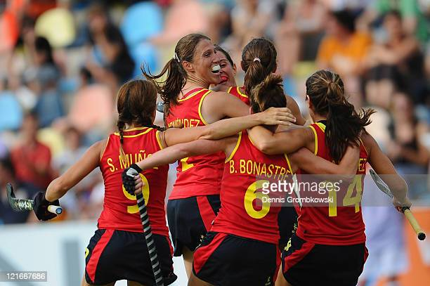 Players of Spain celebrate after scoring their team´s opening goal during the Women´s EuroHockey Championships 2011 Pool A match between Spain and...
