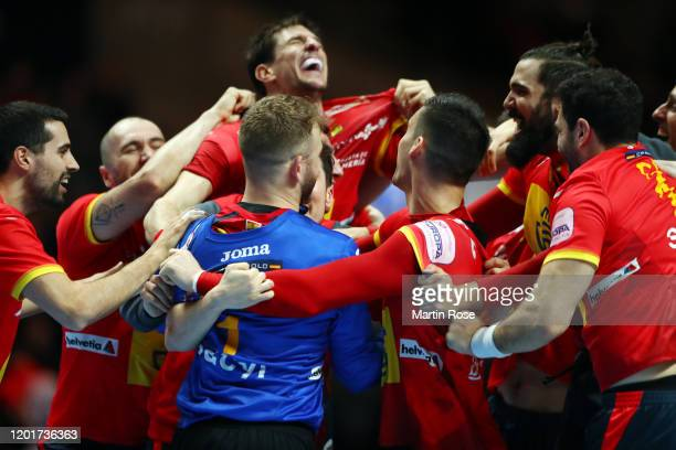 Players of Spain celebrate after winning the Men's EHF EURO 2020 semi final match between Spain and Slovenia at Tele2 Arena on January 24, 2020 in...