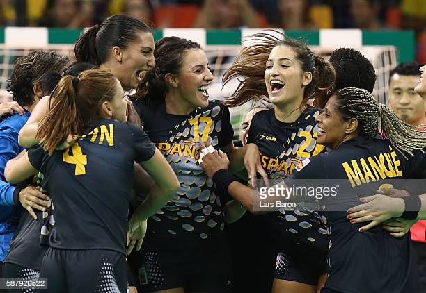 Players of Spain celebrate after winning the Womens Preliminary Group A match between Brazil and Spain at Future Arena on August 10, 2016 in Rio de...