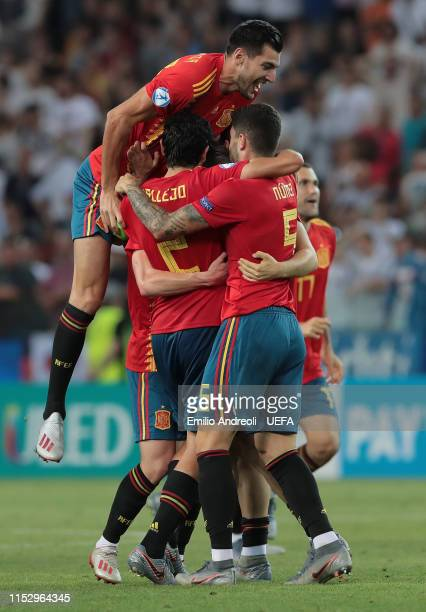 Players of Spain celebrate the victory at the end of the 2019 UEFA U-21 Final between Spain and Germany at Stadio Friuli on June 30, 2019 in Udine,...