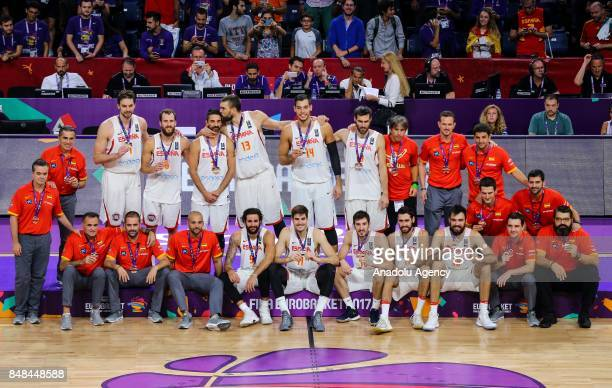 Players of Spain celebrate their teams' victory during the medal ceremony after the FIBA Eurobasket 2017 semi final basketball match between Spain...