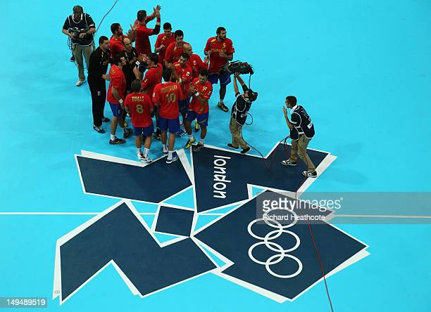 Players of Spain celebrate their victory in the Men's Handball preliminaries group B match between Spain and Serbia on Day 2 of the London 2012...
