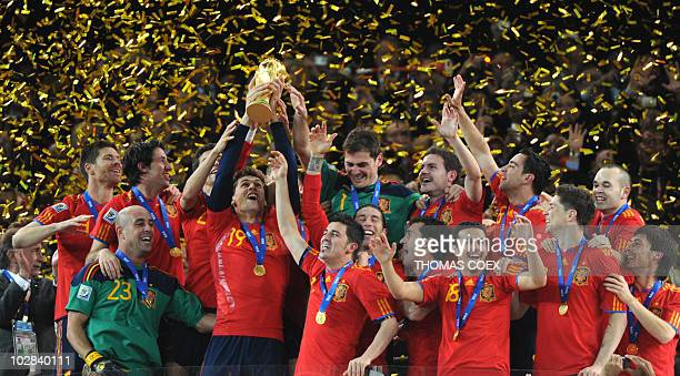 Players of Spain celebrate with the FIFA World Cup trophy after winning the 2010 World Cup football final by defeating The Netherlands during extra...