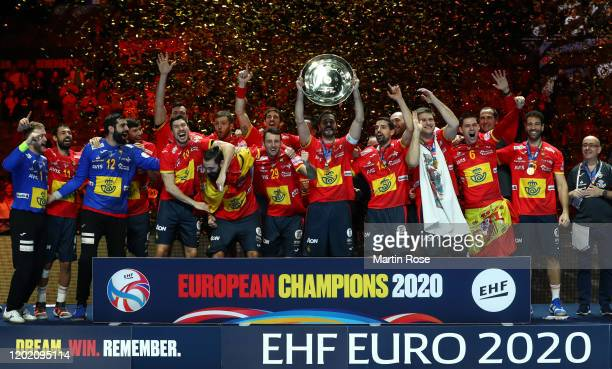 Players of Spain lift the trophy following their team's victory in the Men's EHF EURO 2020 final match between Spain and Croatia at Tele2 Arena on...