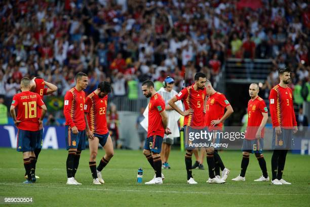 Players of Spain react after losing the penalty shootout during 2018 FIFA World Cup Russia Round of 16 match between Spain and Russia at the Luzhniki...