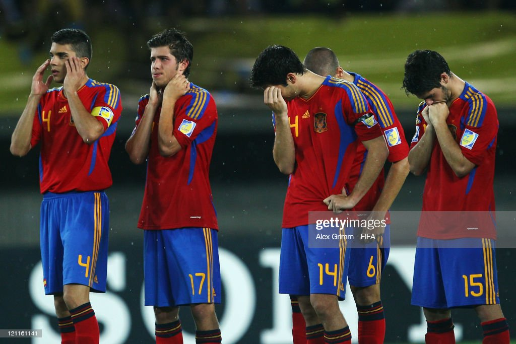 Players of Spain react during the penalty shoot-out at the FIFA U-20 World Cup 2011 quarter final match between Brazil and Spain at Estadio Hernan Ramirez Villegas on August 14, 2011 in Pereira, Colombia.