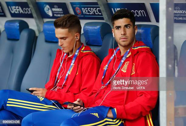 Players of Spain sit on the bench as they arrive prior to the UEFA European Under21 Championship match between Spain and Macedonia at Gdynia Stadium...