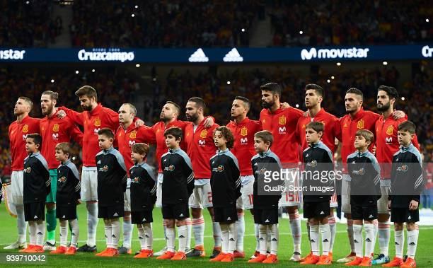 Players of Spain team line up for the national anthem prior to the international friendly match between Spain and Argentina at Wanda Metropolitano...