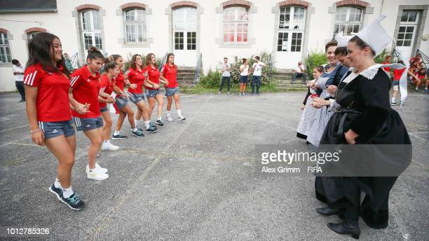 Players of Spain visit a local dance group during the FIFA U-20 Women's World Cup France 2018 on August 7, 2018 in Pont-Aven, France.