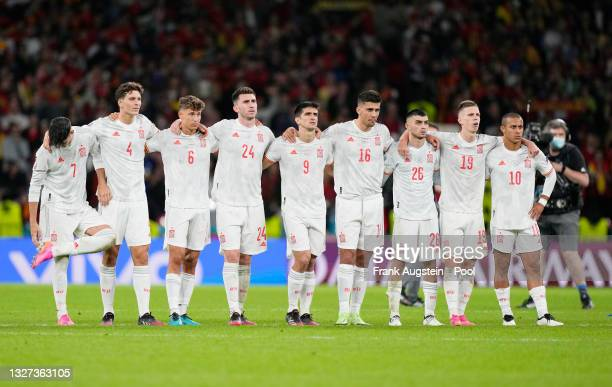 Players of Spain watch the penalty shoot out from the half way line during the UEFA Euro 2020 Championship Semi-final match between Italy and Spain...