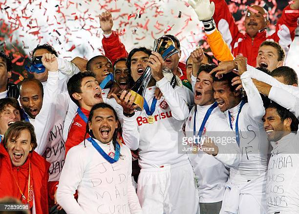 Players of Sport Club Internaciona celebrate with the cup after winning the final of the FIFA Club World Cup Japan 2006 between Sport Club...