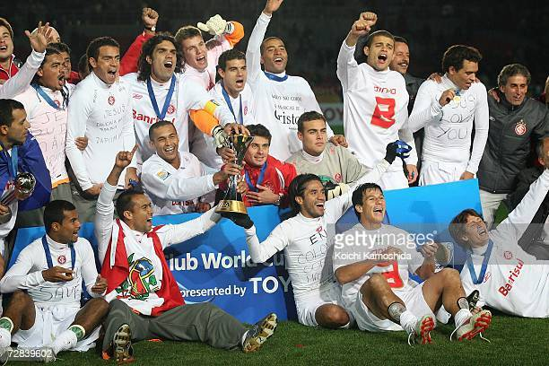 Players of Sport Club Internacional celebrate their victory over FC Barcelona during the awards ceremony of the FIFA Club World Cup Japan 2006 at the...