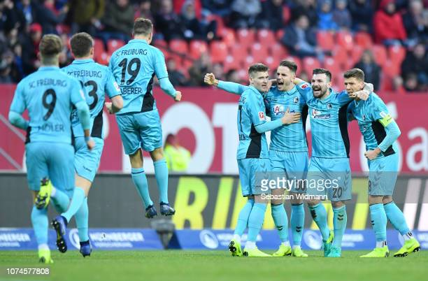 Players of SportClub Freiburg celebrate their sides first goal during the Bundesliga match between 1 FC Nuernberg and SportClub Freiburg at...