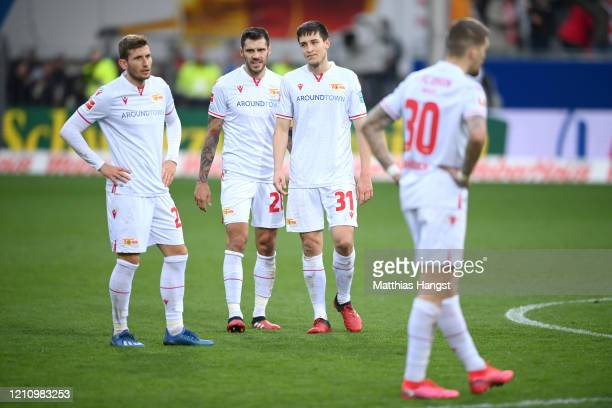 Players of SportClub Freiburg look dejected following their sides defeat in the Bundesliga match between SportClub Freiburg and 1 FC Union Berlin at...