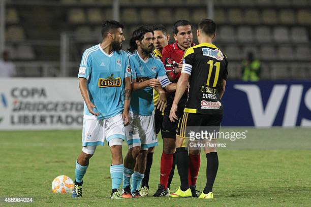 Players of Sporting Cristal argue with Cesar Gonzalez of Deportivo Tachira during a match between Deportivo Tachira and Sporting Cristal as part of...