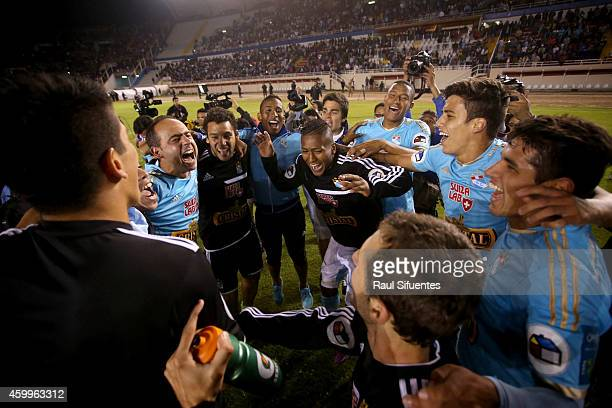 Players of Sporting Cristal celebrate after winning a final match between Alianza Lima and Sporting Cristal as part of Torneo Clausura 2014 at...