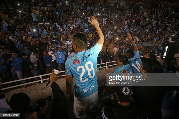 Players of Sporting Cristal greet fans after winning a final match between Alianza Lima and Sporting Cristal as part of Torneo Clausura 2014 at...