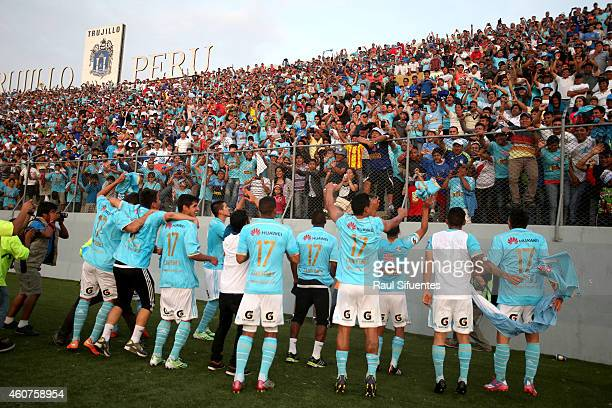 Players of Sporting Cristal greet fans to celebrate after winning a final match between Sporting Cristal and Juan Aurich as part of Torneo...