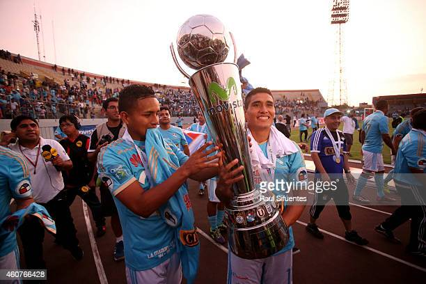 Players of Sporting Cristal raise the trophy after winning a final match between Sporting Cristal and Juan Aurich as part of Torneo Descentralizado...