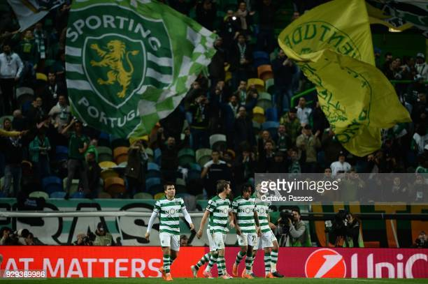 Players of Sporting Lisbon celebrates after scores the second goal during the UEFA Europa League Round of 16 first leg match between Sporting Lisbon...