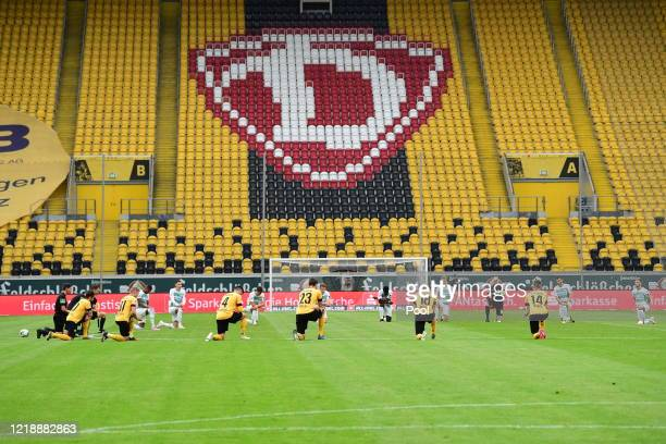 Players of SpVgg Greuther Fuerth and Dynamo Dresden kneel to show solidarity with the protests against racism prior to the Second Bundesliga match...