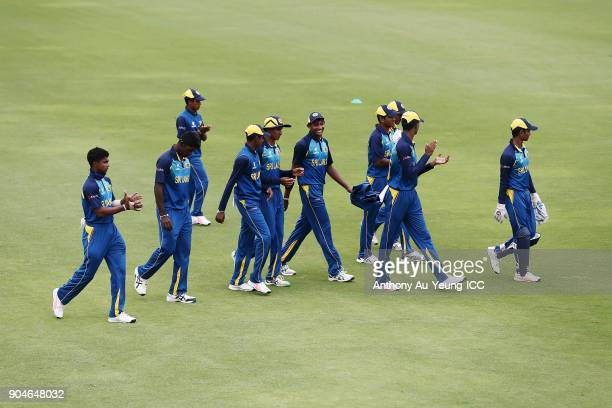 Players of Sri Lanka come off the field after their first innings during the ICC U19 Cricket World Cup match between Sri Lanka and Ireland at Cobham...
