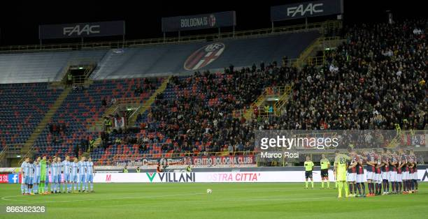 Players of SS Lazio and Bologna listen to a speaker reading a passage from the diary of holocaust victim Anne Frank before during the Serie A match...