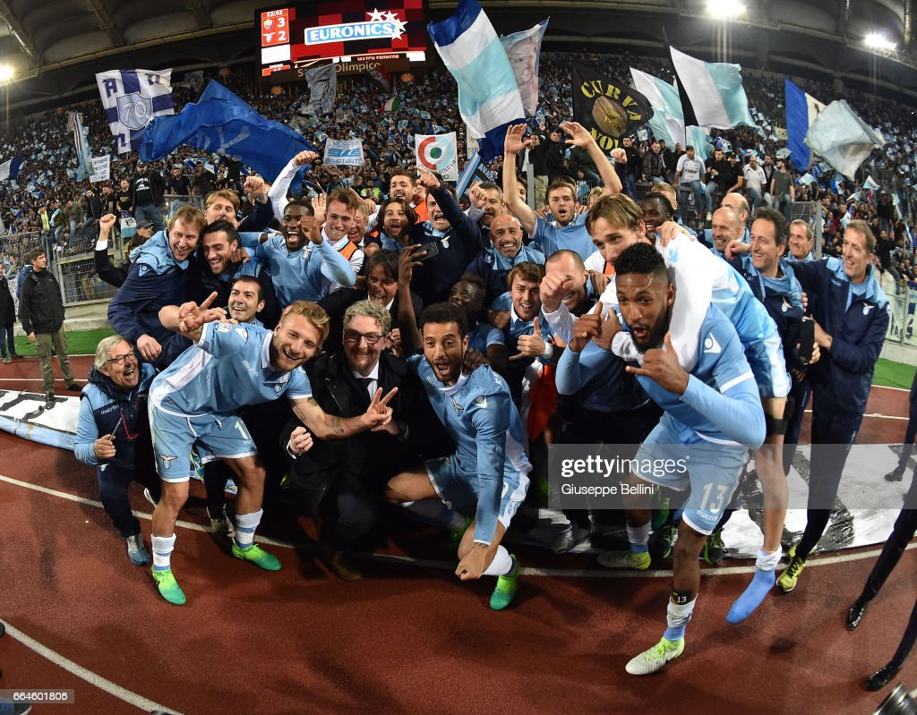 Players of SS Lazio celebrate the victory after the TIM Cup match between AS Roma and SS Lazio at Stadio Olimpico on April 4, 2017 in Rome, Italy.