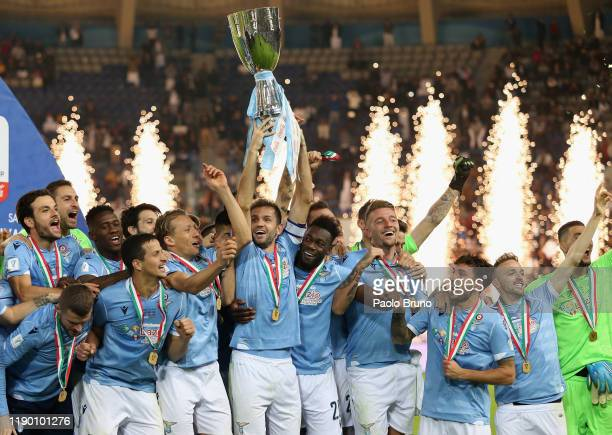 Players of SS Lazio celebrate the victory of the Italian Supercup trophy after the Italian Supercup match between Juventus and SS Lazio at King Saud...