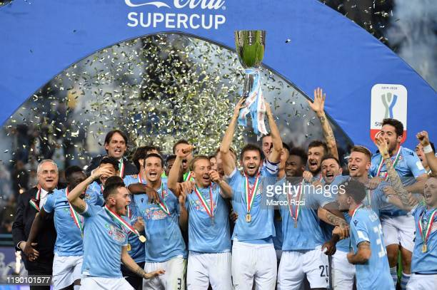 Players of SS Lazio celebrate the winning of Supercup with the trophy after the Italian Supercup match between Juventus and SS Lazio at King Saud...