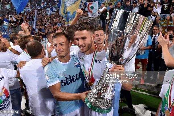 Players of SS Lazio Stefan Radu Wesley Hoedt celebrate the victory after the Italian Super Cup soccer match between FC Juventus and SS Lazio at...
