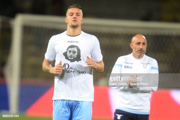 Players of SS Lazio wear a shirs depicting Anne Frank saying 'no to antiSemitism' in response to antisemitic graffiti left by their fans at a...