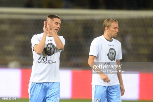 Players of SS Lazio wear a shirt depicting Anne Frank saying 'no to antiSemitism' in response to antisemitic graffiti left by their fans at a...
