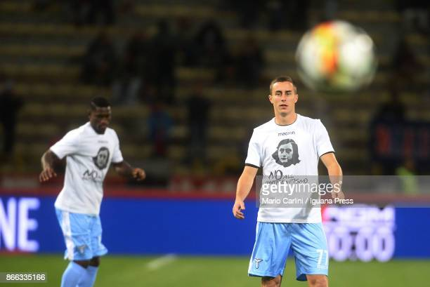 Players of SS Lazio wear a shirts depicting Anne Frank saying 'no to antiSemitism' in response to antisemitic graffiti left by their fans at a...