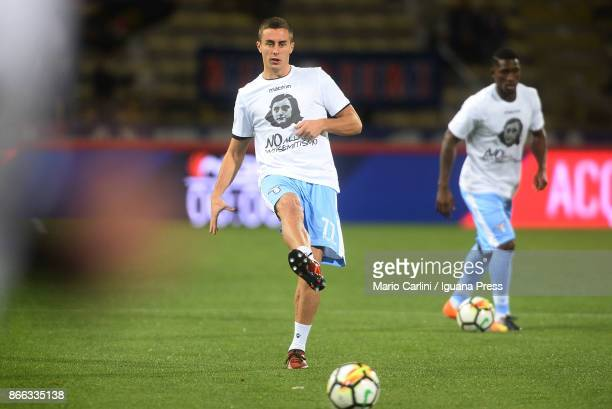 Players of SS Lazio wear shirts depicting Anne Frank saying 'no to antiSemitism' in response to antisemitic graffiti left by their fans at a previous...
