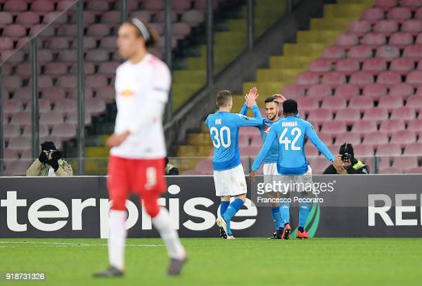 Players of SSC Napoli Adam Ounas Marko Rog and Amadou Diawara celebrate the 10 goal scored by Adam Ounas beside the disappointment of Yussuf Poulsen...