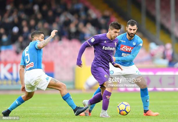 Players of SSC Napoli Allan and Raul Albiol vies with ACF Fiorentina player Giovanni Simeone during the Serie A match between SSC Napoli and ACF...